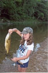 Click to enlarge image Jenna and her Bass - Fish from your Canoe or the River Bank -